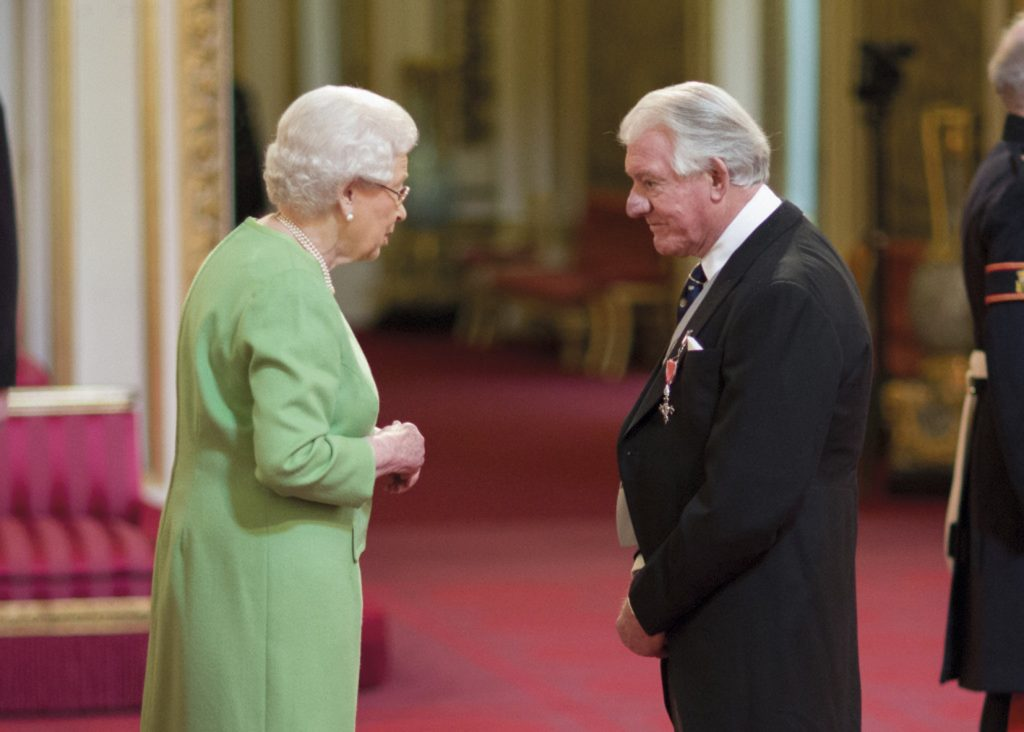 angus-recieving-mbe-from-queen-credit-image-courtesy-of-british-ceremonial-arts-limited-1024x732